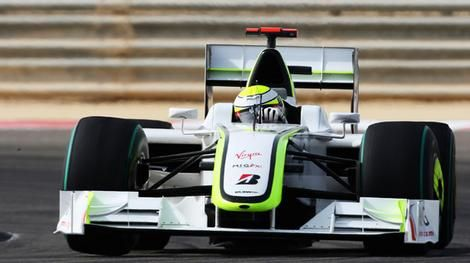 Jenson Button of Brawn GP drives on his way to winning the Bahrain ...