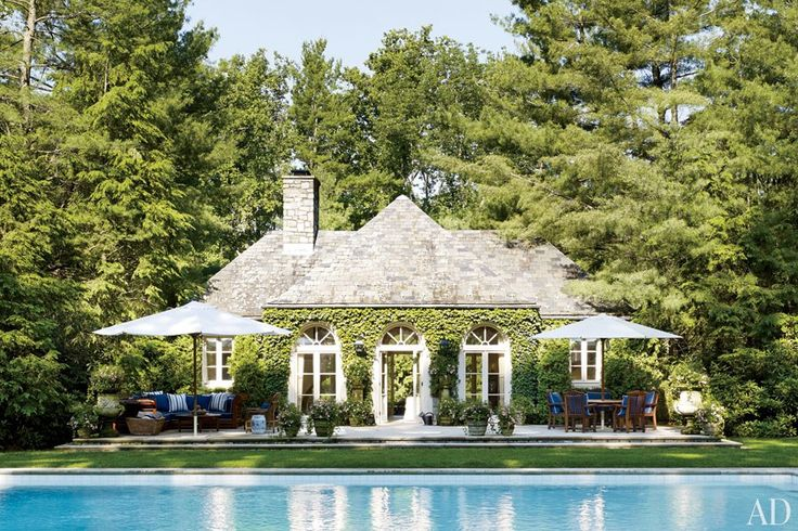 Ralph Lauren's Bedford poolhouse is surrounded by towering pines   archdigest.com