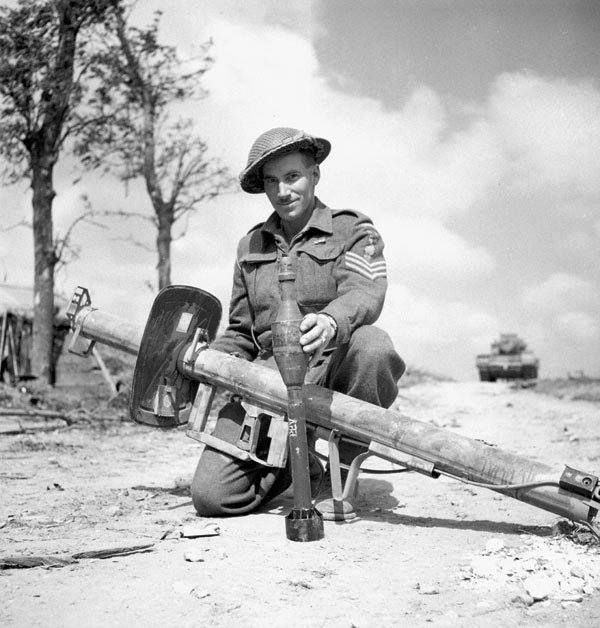 A Canadian soldier with a captured Panzerschrek