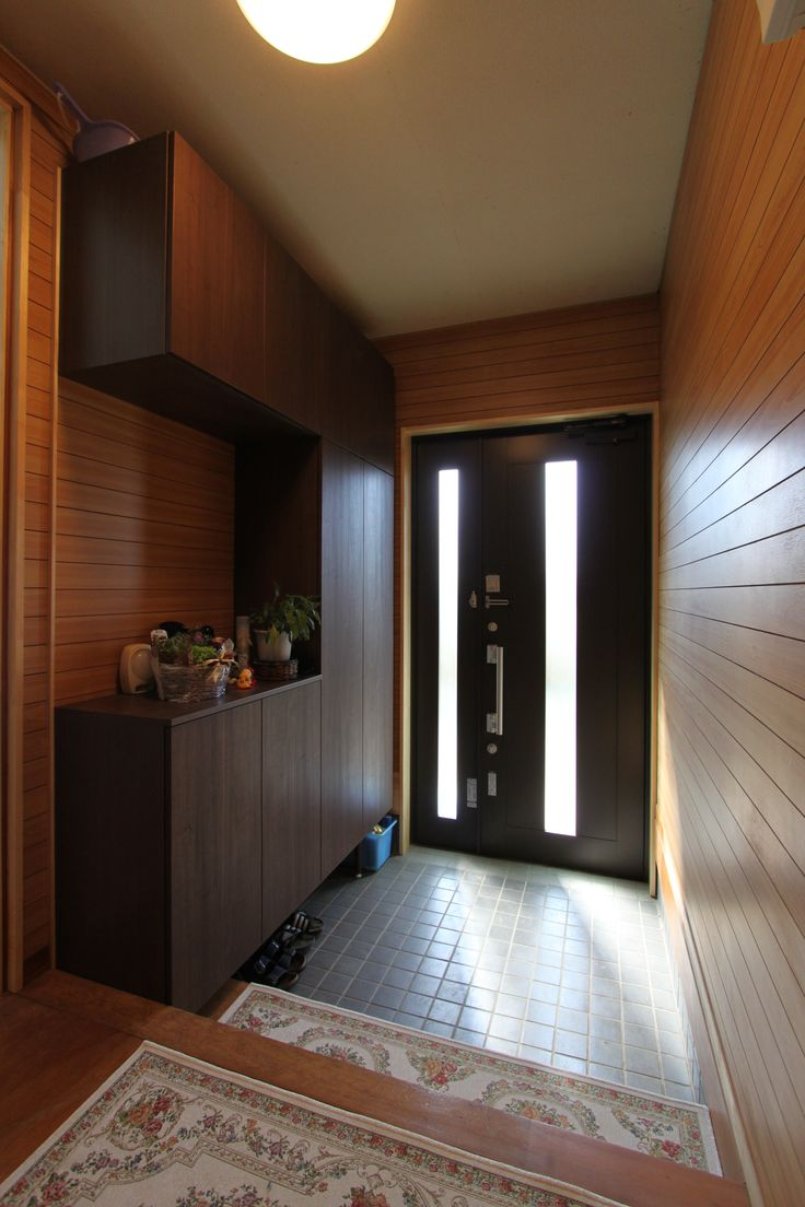 This is what we're envisioning for the entry: a mixture of tall and shoe cabinets and a tiled floor. It may also be nice to have somewhere to sit in this area.
