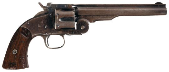 S&W 'Schofield' No3 revolver    Georges W. Schofield's 1873 patent based on the 1870 model, manufactured by Smith and Wesson c.1877 for the US Army - serial number 6338.  .45 Schofield six-round cylinder, top-break single action, 7″ barrel.  A classic, it was designed for cavalry use and secured a small military contract shortly after. This led this model to see some action in the Geronimo campaign.