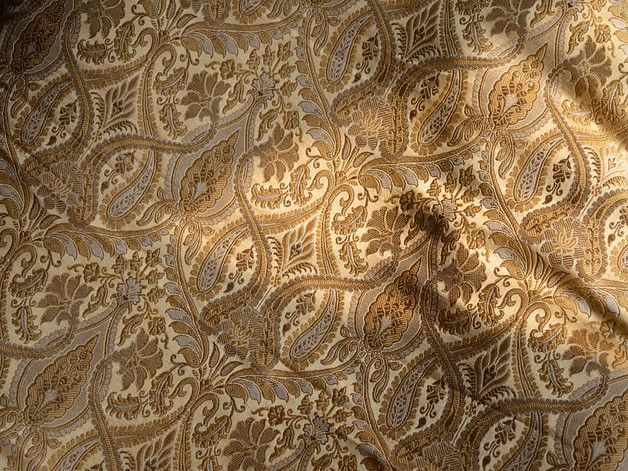 This is a beautiful pure heavy benarse silk brocade floral design fabric in Beige and Gold. The fabric illustrate golden woven floral vines on Golden Beige background.  You can use this fabric to...