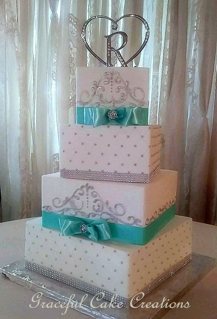 https://flic.kr/p/Gx49ih | Elegant Square White Butter Cream Wedding Cake With Tiffany Blue Ribbon and Silver Bling Ribbon, Silver Scrolls and Silver Dragee's