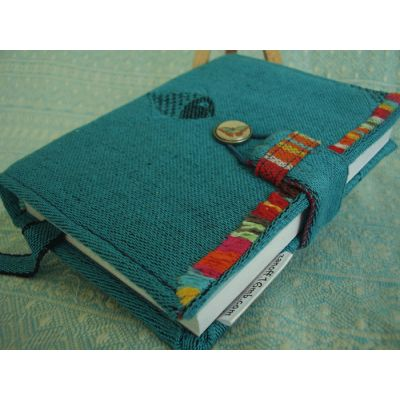 a scrap of DIDYMOS Fische Caribe Limited Edition babywrap made the textile cover for this pocket notebook.