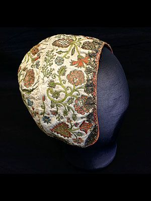 Silk coif, hand-embroidered with polychrome silk and metallic floss, circa 1680-1720