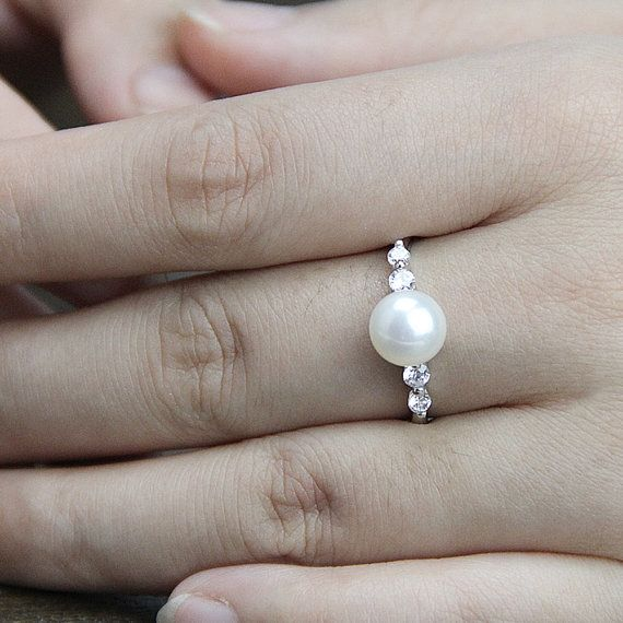 Item No: RIN008  Item: genuine freshwater pearl ring  Pearl shape: near round button  Pearl size:8-9mm  Pearl color: ivory white/ white,purple,pink