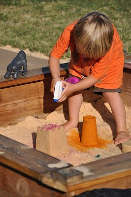 Spray bottle with liquid watercolor gives you colored sand castles