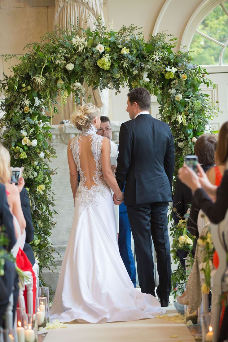 Flowing floral foliage Wedding Arch Aynhoe Park Joanna Carter Wedding Flowers