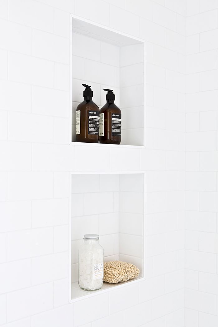 Looking for small master bathroom ideas? Step inside a dark and dated bath that was quickly transformed with new tiles and a fresh coat of paint.