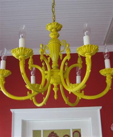 Have an outdated brass light fixture?  Before you buy a new one.. try spray paint.  Love this unexpected yellow hue:)