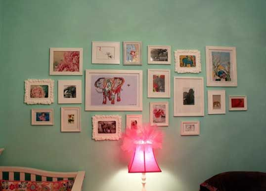 Different style white frames and elephant themed artwork. Cute!