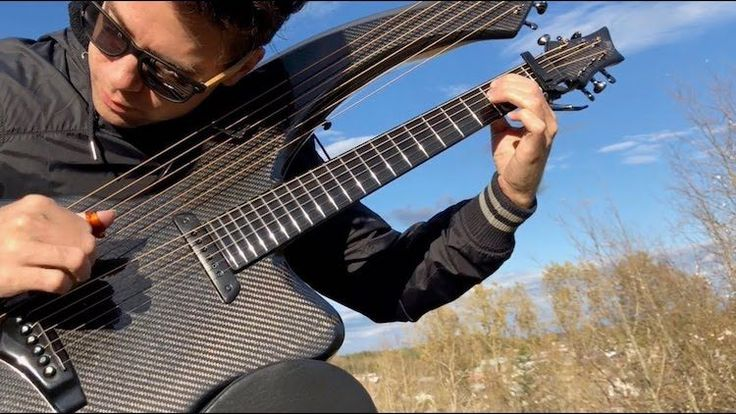 A Stunning Cover Of The Rolling Stones Song Paint It Black Played On A Gorgeous Carbon Fiber Harp Guitar Guitar Guitar Lessons Songs Rolling Stones