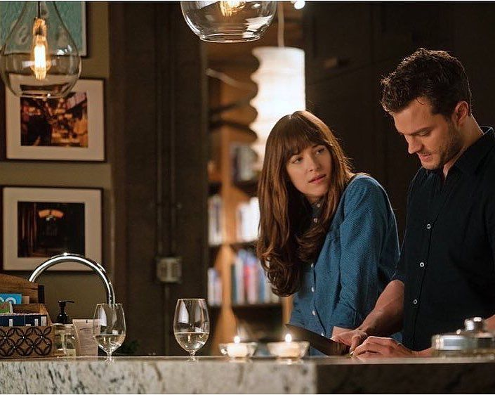 New picture from Fifty Shades Darker of Ana and Christian cooking! #fiftyshades #fiftyshadesdarker