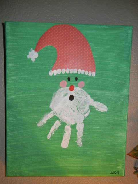 Hand print Santa face with a scrapbook paper hat!