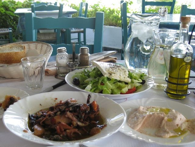 A memorable meal in Paleochora on the south coast of Crete, Greece: Greek salad, taramasalta (fish roe dip), and an exquisite squid and potato stew