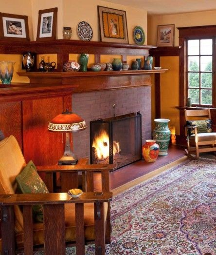 Antique and reproduction furniture, textiles, and pottery mingle in the living room of the restored 1906 Bungalow