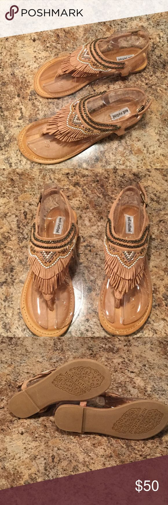 "Not Rated gladiator flat sandal Not Rated gladiator inspired flat tan sandal. Fringe studded thong strap with buckle closure at ankle. Heel 0.5"". Size 7.5. NWT. Super Cute for any occasion - dress them up or wear them any casual day. Any questions or want more pictures? Just ask! Not Rated Shoes Sandals"
