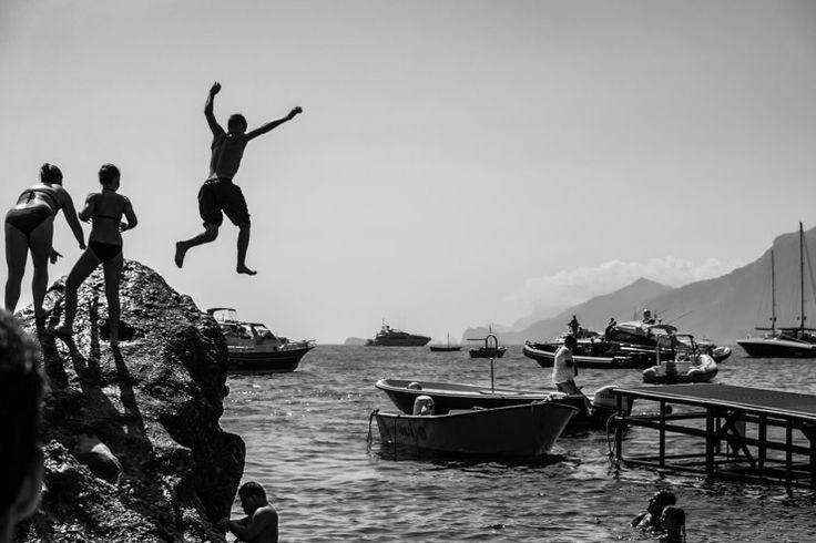 Jumping off rocks at Da Adolfo Restaurant, Positano, Amalfi Coast, Italy