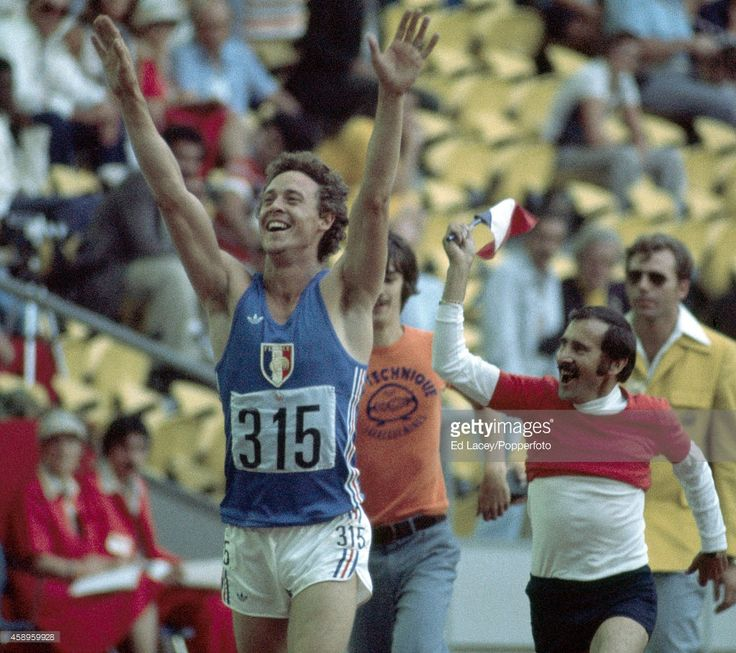 Guy Drut of France (315) after winning the men's 110 metres hurdles event during the Summer Olympic Games in Montreal, circa July 1976.