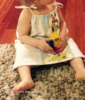 AS-kartelut: Mekko lapselle tyynyliinasta