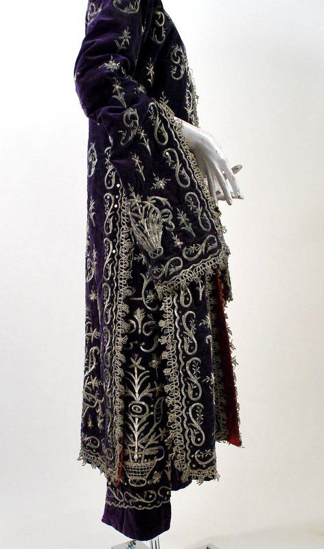 19th Century Ottoman Silver Emboidered Velvet Wedding Caftan. Beautiful silver padded stitch embroidery with delicate gimp trimmings. Opening robe with no closures, deep side vents, lined in red satin that is a replacement. With metal spangles.
