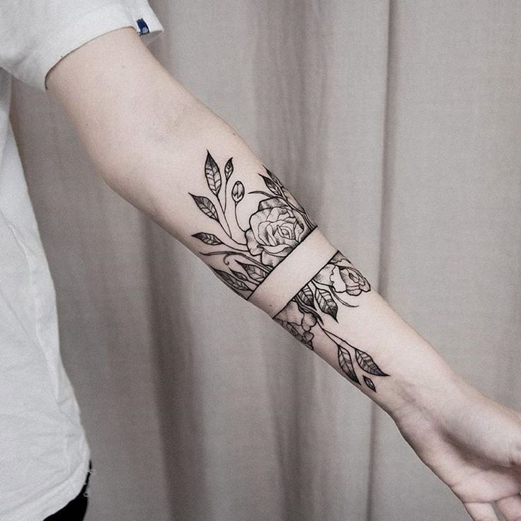 Black ink rose tattoo with split in the same arm by dogma_noir – Svetlana Smith