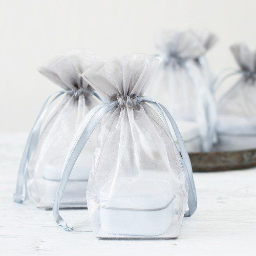 Sheer organza favor bags are the perfect way to show off a gift too pretty to hide.  Fill them with jewelry for your bridesmaids or jordan almonds for your wedding guests.  These favor bags are diverse enough for almost any event.  Available in 23 solid colors and three sizes, you're sure to find the right combination for any purpose.