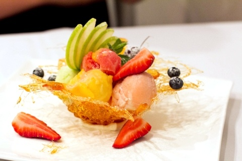 Homemade sorbets and fresh seasonal fruits in a spun toffee basket - from Queensland's best restaurant