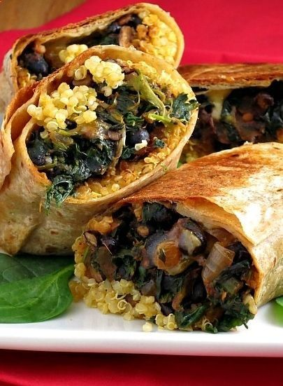 Black Bean Spinach Quinoa Burritos are protein-packed with black beans and quinoa, and healthy vegetables. Easy to whip together and then baked to perfection! great for the freezer Check out more recipes like this! Visit yumpinrecipes.com/