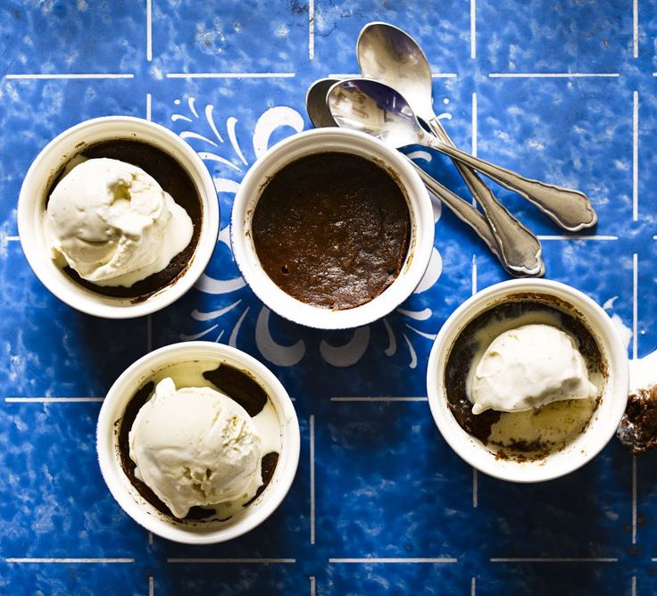 Hot mocha puddings. It only takes a few minutes to mix, microwave and top these hot chocolate puds with ice cream and liquer for a rich, indulgent dessert