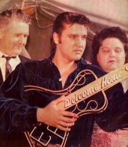"""Elvis with Parents at Tupelo Concert, September 26, 1956. Elvis was given a """"welcome home"""" guitar with the initials """"EP"""" on it aka The Key to the City."""
