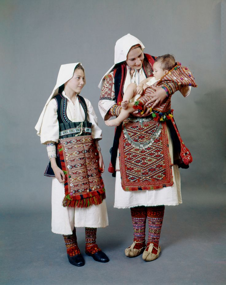 Woman and children in their best costumes of Antartiko, Florina, Macedonia