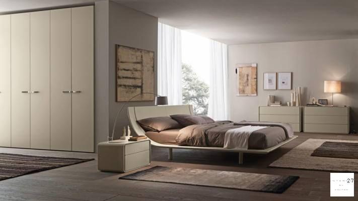 Il letto Aqua disponibile nella versione legno o imbottita ...