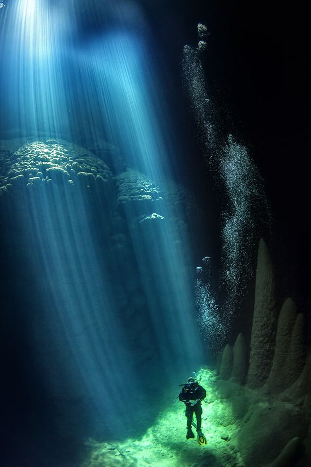 Abismo Anhumas - A cave in Bonito, Mato Grosso do Sul (in Brazil). This cave is equipped with a scuba diving platform and sunlight reaches down to the bottom during certain parts of the day. Click for awesome panoramic pictures.
