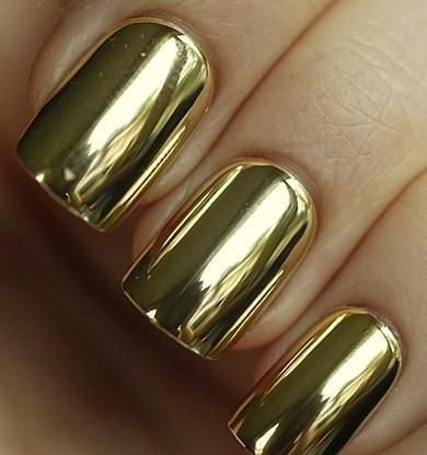 gold polish....not sure if this is really my style but it sure is interesting. Would love to see what other things this could be painted on to get this high gloss effect?!