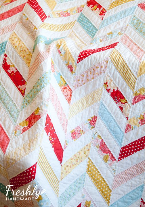 I love the pattern with a dash of modern prints = perfect. Freshly Handmade: Marguerite Herringbone Quilt: Finished