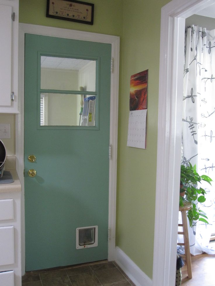 Sherwin Williams restful (sw6458) on the door and and hearts of palm (sw6415) on the wall. Love this combo