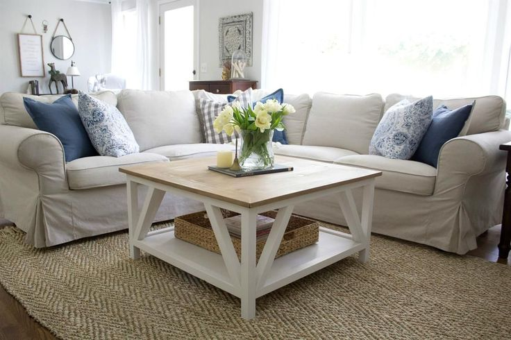 Classic square coffee table with painted base and rustic stained table top complete with bottom shelf for storage. Perfect for living rooms with sectionals!