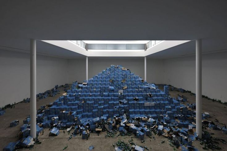 """The Recovery of Discovery by Cyprien Gaillard: A 72,000 bottle pyramid of beer ------- After signing a waiver participants are free to climb, open, and consume as many bottles of """"Efes"""" beer as they desire"""