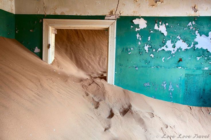 Kolmanskop: A Ghost Town Swallowed by the Desert - Doorway filled with sand