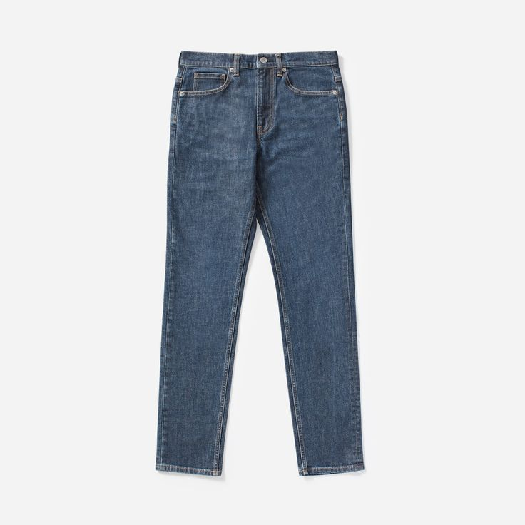 $68 Slim Fit Jean SOLD by Everlane - affiliate - Easy and slim—but not skinny. These jeans are made of premium 11 oz Japanese denim that feels substantial, but has a touch of stretch for comfort.      MADE at the world's cleanest denim factory!      Slim fit. Slim through the hip and thigh, with a slightly tapered leg. Regular rise.