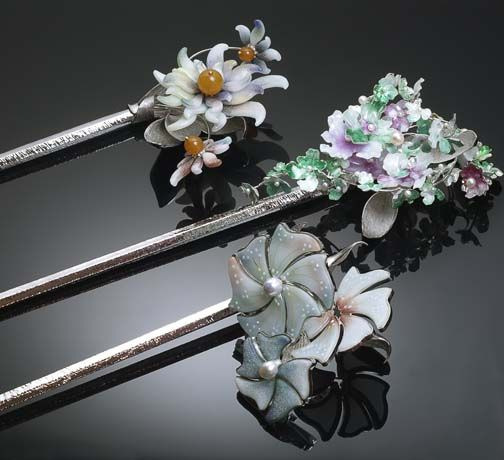 Winners of 2013 Saul Bell Awards: First Place Enamel: Trio of Binyeo, or, traditional Korean ornamental hair pins, formed with silver, 22k gold, and enamel and featuring a fairy tale about a woodcutter told visually on each piece; by Inja Kim of Seoul, South Korea