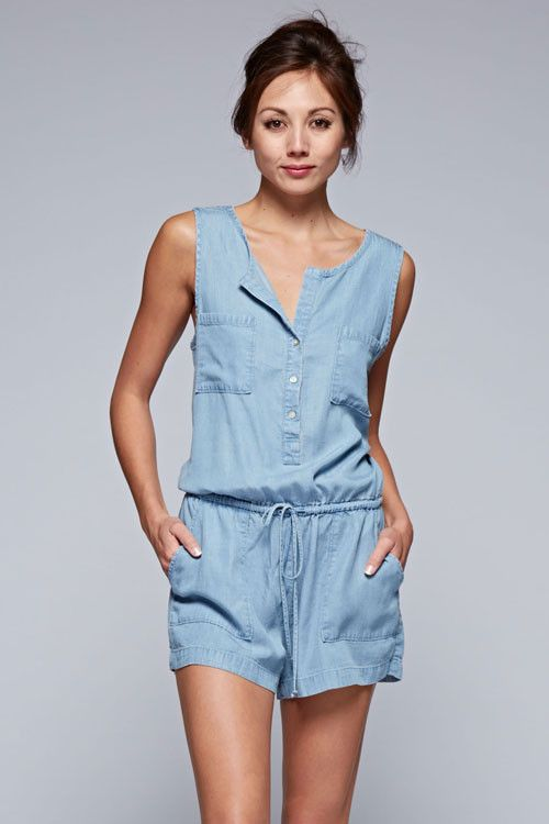 Sleeveless comfy casual denim romper. Front button down with self drawstring tie and pockets. Content + Care: 100% Tencel Machine Washable