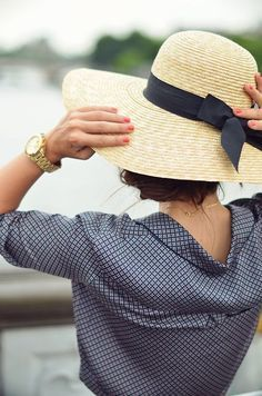 Straw hat with a darling black bow band.