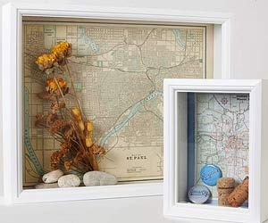 Show-off boxes  To document trips, create shadow boxes with neighborhood or city maps mounted in back. (You can trim small city maps from larger road maps.) Add souvenir buttons, wine corks, concert tickets and other vacation keepsakes.