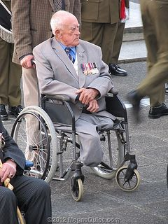 Old soldier heads toward the cenotaph