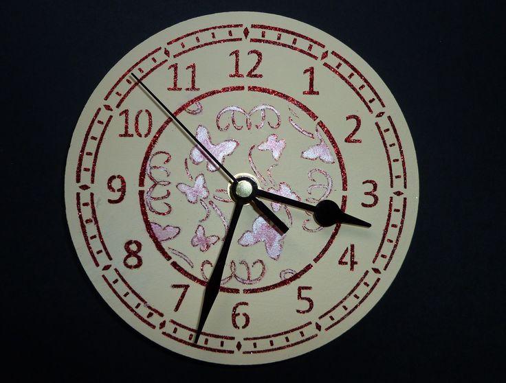 Small 'Butterfly Swirl' MDF clock.  Imagination Craft's - Small MDF clock kit.  Small clock face stencil.  Bright Red Sparkle Medium.  Metal spatula.  Pearly paint palette.  Small round 'Butterfly Swirl' stencil.  Limestone MDF paint.  January 2015.
