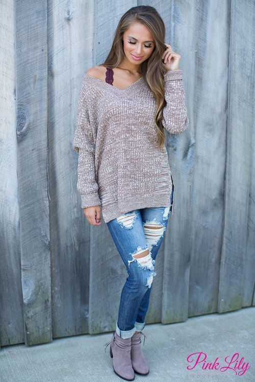 This sweater will make you so happy! You'll never worry about finding something cute to wear in cold weather while still looking super cute when you have this in your closet!