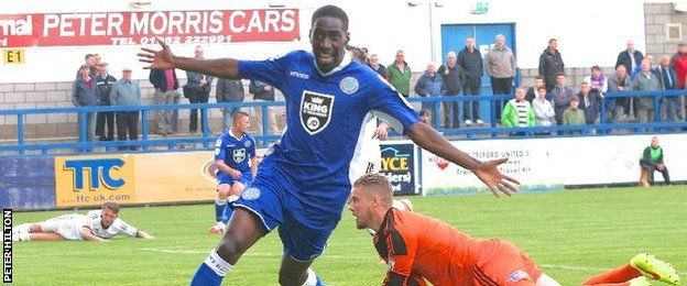 Adriano Moke celebrates a goal for Macclesfield Town