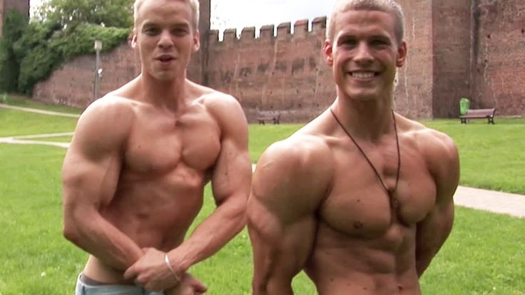 Two junior bodybuilders flex their muscles